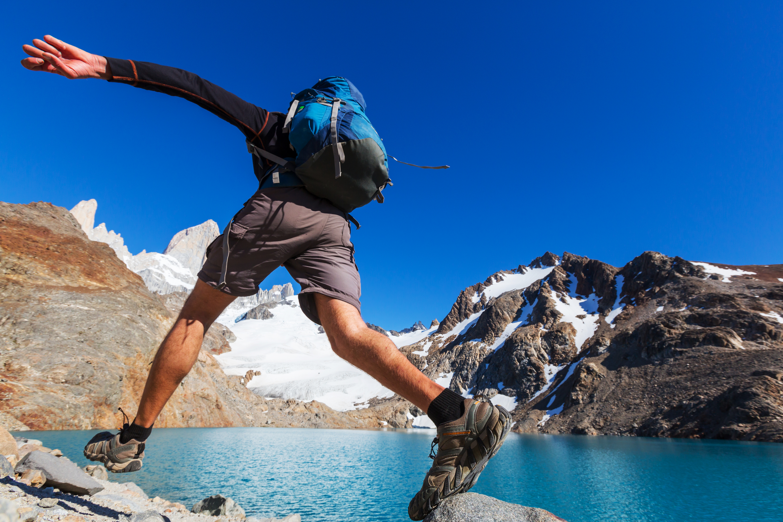 Man jumping on rocks during a hike in Patagonia