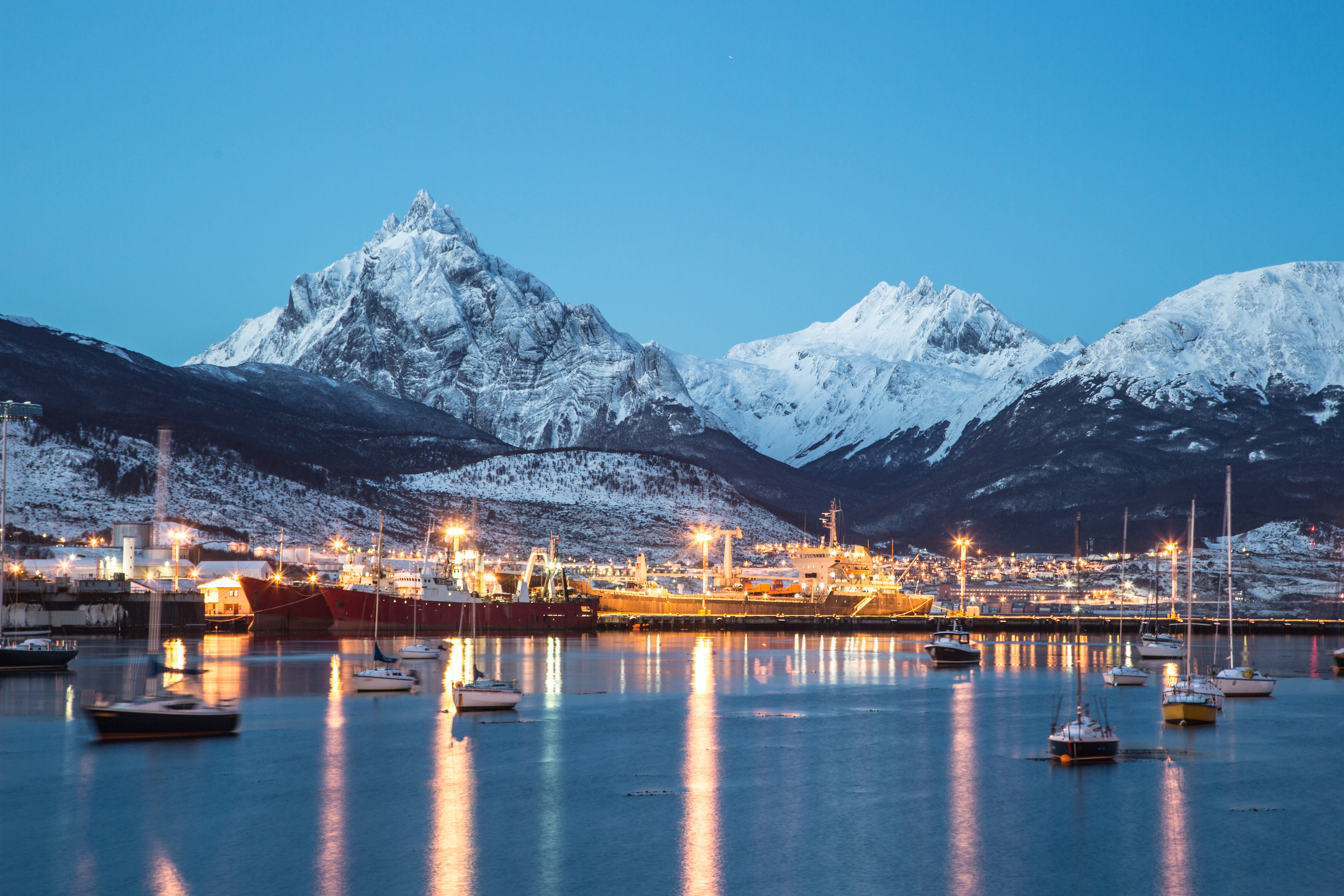 ushuaia with ships and mountains
