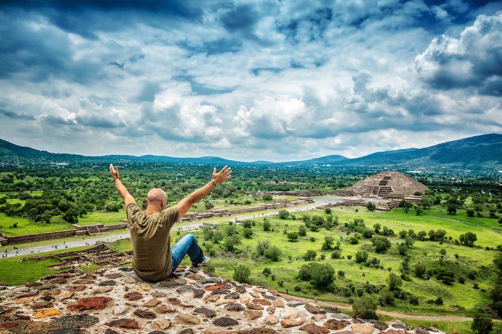 chichen Itza Pyramids of the Sun and the Moon on the Avenue of the Dead, Teotihuacan ancient city, old ruins of Aztec civilization, happy man enjoying traveling, Mexico