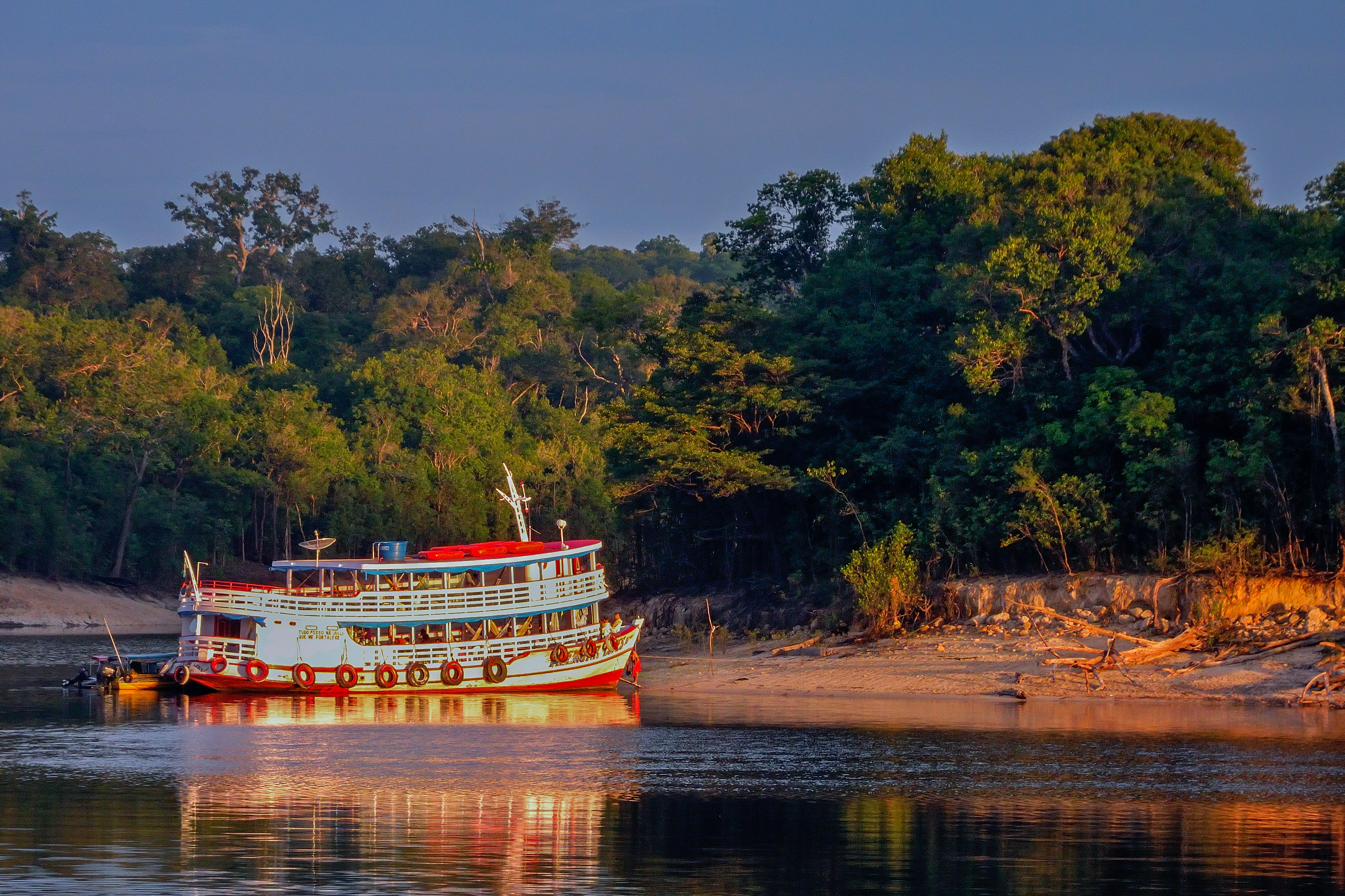 a boat cruising down the amazon in Brazil