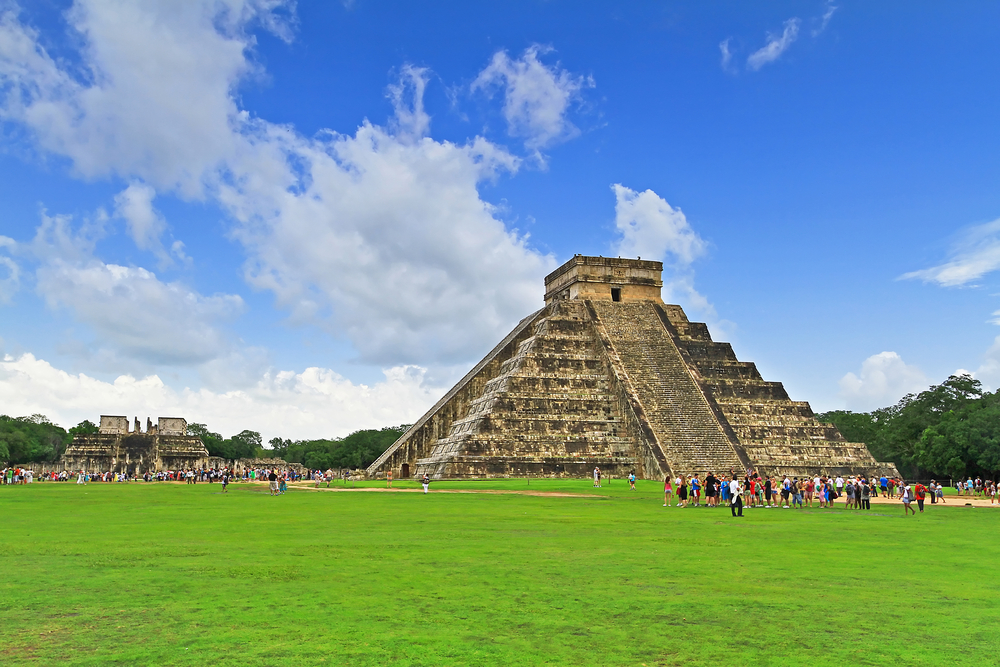 The historic pyramids of Chichen Itza with people