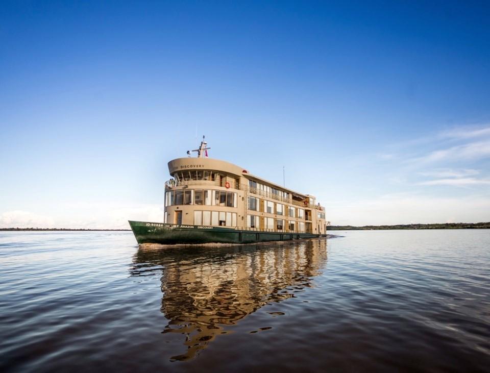 Explore the Amazon: photo of a small ship cruising the Amazon river