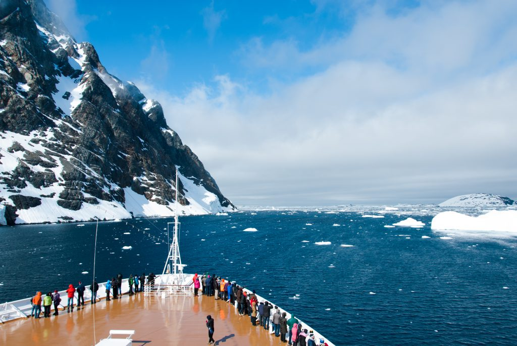 Mountains and cruise ship in Antarctica Antarctica Expedition in sunny day