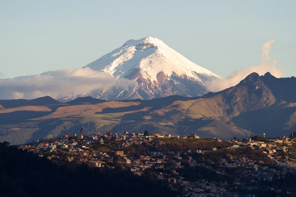 Cotopaxi volcano on the background, and the city on the front