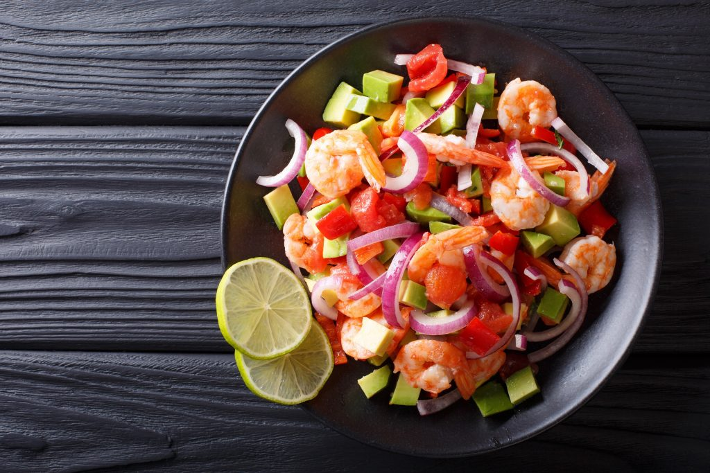 Delicious ceviche of shrimp with vegetables, spices and lime