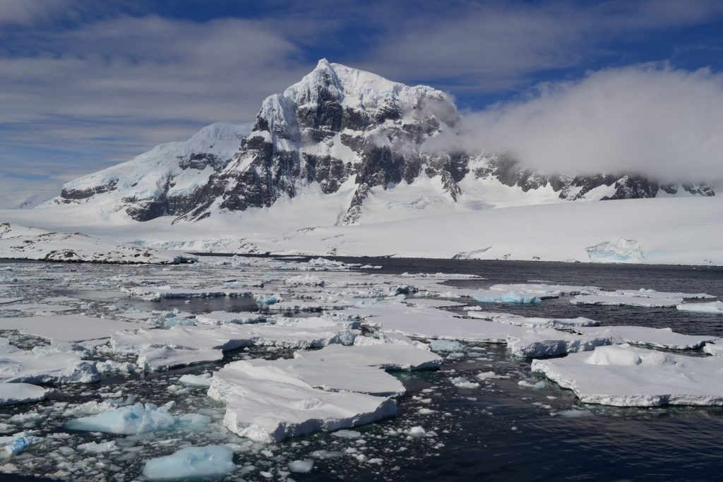 Scenery in Antarctica of snow capped mountain and icy waters credit: Simon Evans