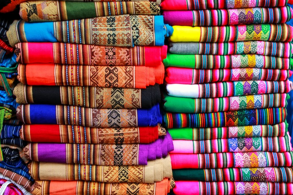 lima market with colourful alpaca wool products displayed credit shuterstock
