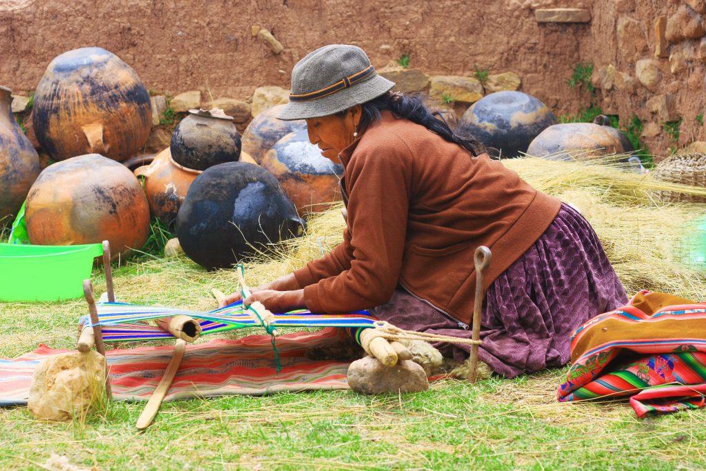 Woman weaving Peru credit Shutter stock