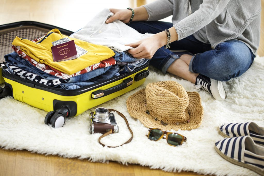 Preparation yellow travel suitcase at home credit: Shutter stock