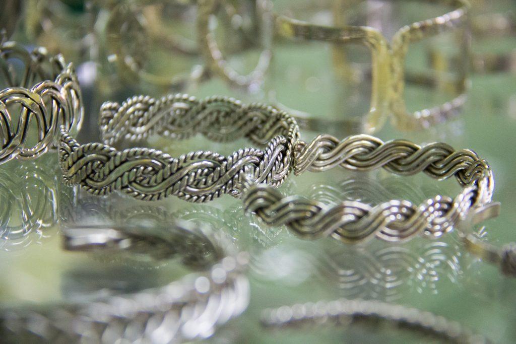 Silver bracelets on sale in a Mexican jewelry store credit shutterstock