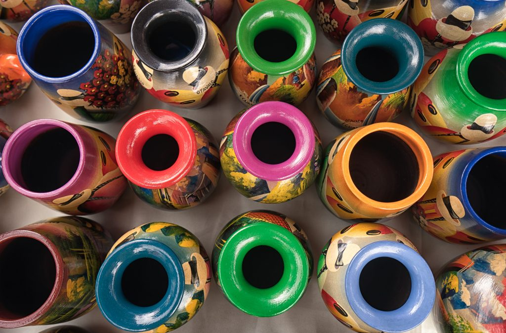 Otavalo, Ecuador- February 17, 2018: colourful indigenous potteries for sale in the weekly artisan market credit shutterstock