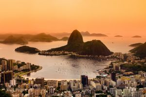 Rio de Janeiro, Brazil. Suggar Loaf and Botafogo beach viewed from Corcovado at sunrise. credit shutterstock
