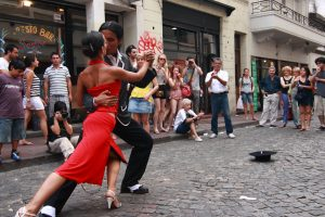 BUENOS AIRES - FEBRUARY 25: A pair of tango dancers perform on February 25, 2009 in San Telmo in Buenos Aires, Argentina. The tango dance originated from Buenos Aires and Montevideo, Uruguay. credit shutterstock