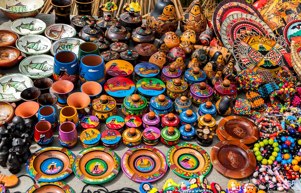 Peruvian souvenirs and toys on the market credit shutterstock