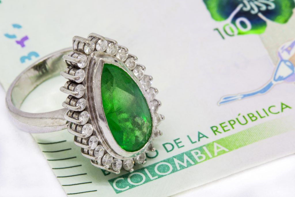 Colombian Emerald Ring and 2016 issued bills credit shutterstock