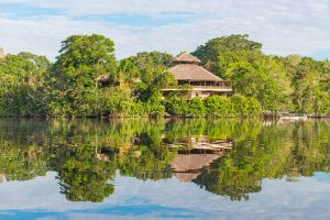 Jungle lodge located by the Amazon river. The tributaries of the Amazon traverse the countries of Guyana, Ecuador, Peru, Brazil, Colombia, Venezuela and Bolivia. credit shutterstock