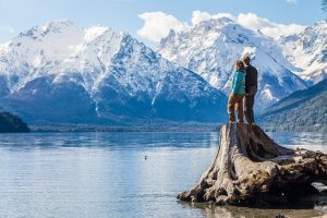 A couple admiring some very scenic views outside Bariloche, Patagonia, Argentina credit shutterstock