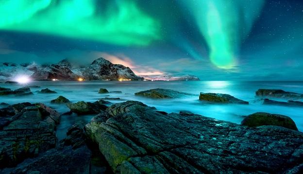 Aurora borealis above the snowy islands of Lofoten.