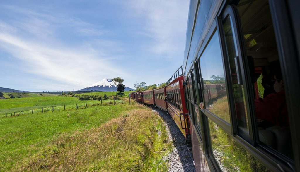A view from the window of the famous 'Train of the Volcanoes' route that passes near many active volcanoes in Ecuador. In the picture is the Cotopaxi volcano to be seen in a sunny day.