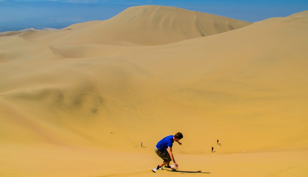 Sand-boarding fun on Atacama Desert, Oasis of Huacachina