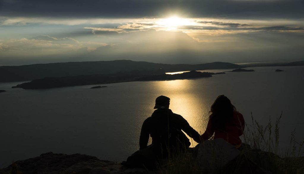 Couple watching the sunsest at Lake Titicaca