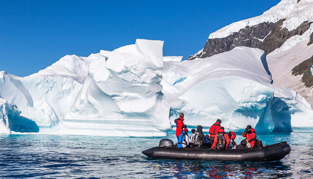 People in a zodiac near Cuverville island, Antarctic peninsula