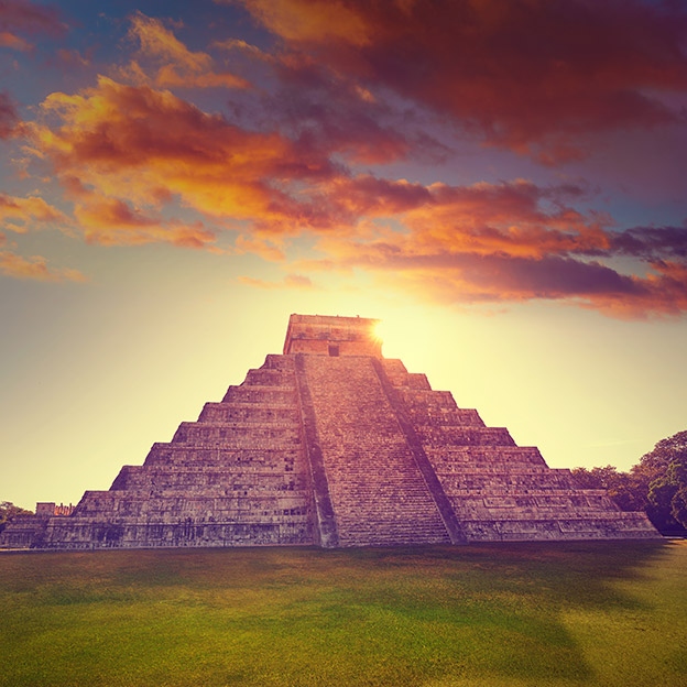 Sunrise at El Templo Kukulcan temple, Yucatan, Mexico