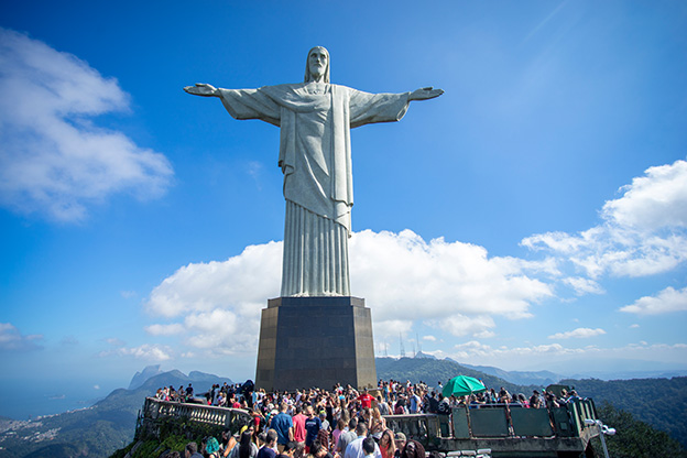 Crowd of tourists on top of the Corcovado mountain in Rio de Janeiro, Brazil