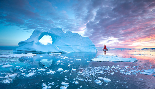 A Sail boat provides perspective in the Arctic