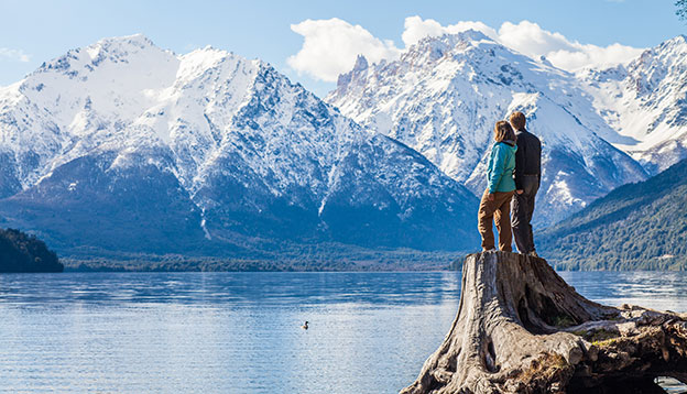 A couple admiring some very scenic views outside Bariloche, Patagonia, Argentina.