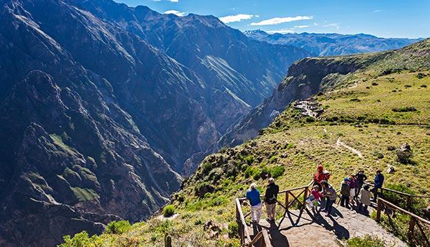 Unidentified tourists at the Cruz Del Condor viewpoint, Colca Canyon, Peru