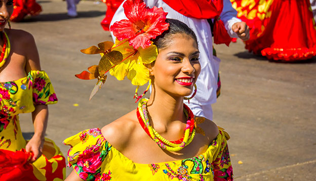 South American culture: Performers with colorful and elaborate costumes participate in the Great Parade of Carnaval Smiling woman