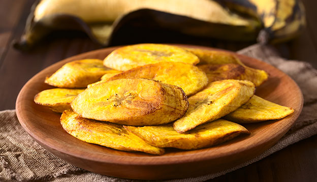 Fried slices of ripe plantains, traditional and popular snack and accompaniment in Central and Northern South America, photographed with natural light