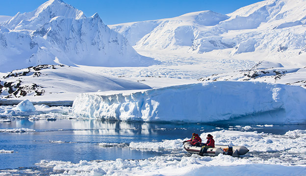 2 people in a zodiac in Antarctica