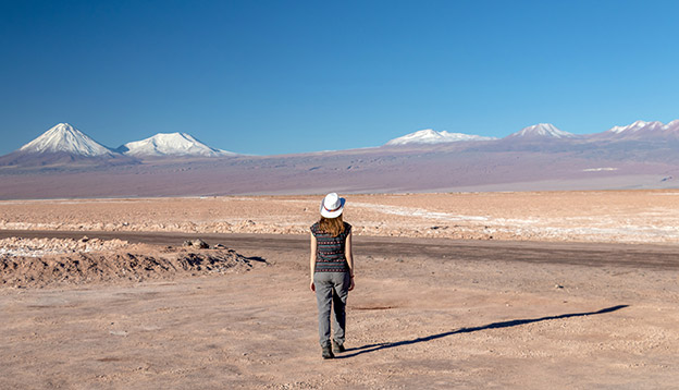 Solo female traveller hiking in the Atacama Desert, Chile