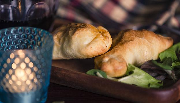 Close up of 2 Patagonian lamb stuffed empanadas