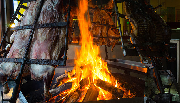 Photo of lamb roasting in front of a fire - Patagonian style
