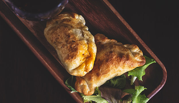 Close up of lamb stuffed empanadas from Patagonia
